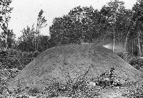 Hot charcoal mound in the Pyrenees: major source of fuel for cooking and automobiles during war